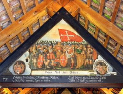 Bức tranh hình tam giác với những vần thơ trên khung tranh và những huy hiệu của người cung hiến tranh